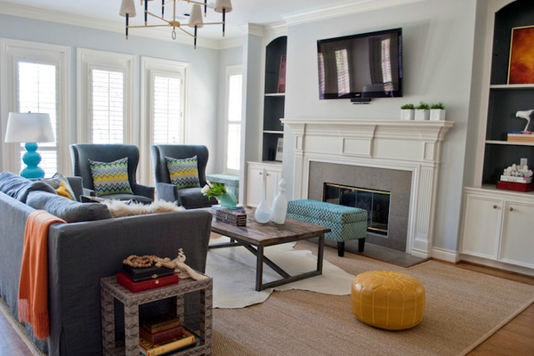 Cowhide Rug Over Sisal Rug In Living Room Twoinspiredesign